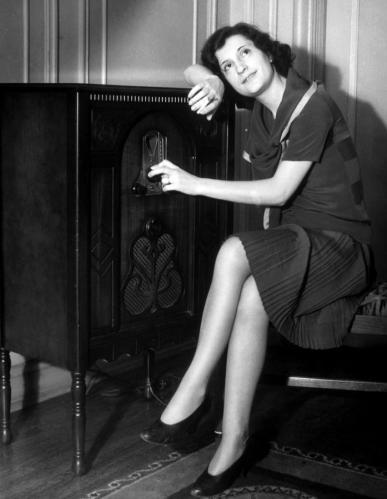 woman-listening-to-a-radio